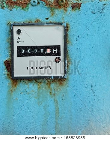 Old Electric Meter Measurement Tool on The Blue Metal Grunge Wall.