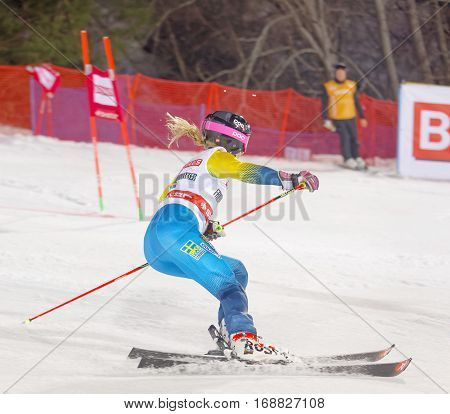 STOCKHOLM SWEDEN - JAN 31 2017: Side view of Frida Hansdotter (SWE) in the parallel slalom downhill skiing at the Alpine Audi FIS Ski World Cup - city event January 31 2017 Stockholm Sweden
