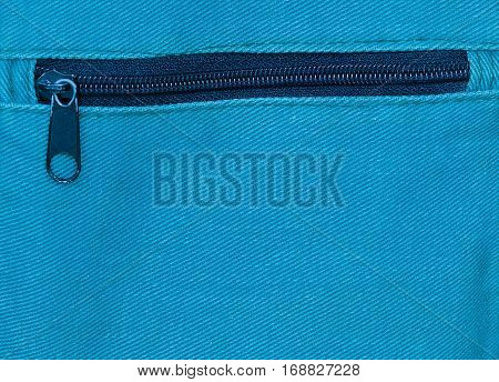 Fabric Texture Close Up of Metal Zipper on Blue Canvas Bag Pattern Background.