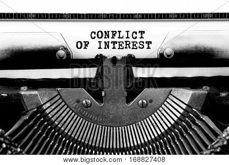 Conflict of interest Typed Words On a Vintage Typewriter Conceptual