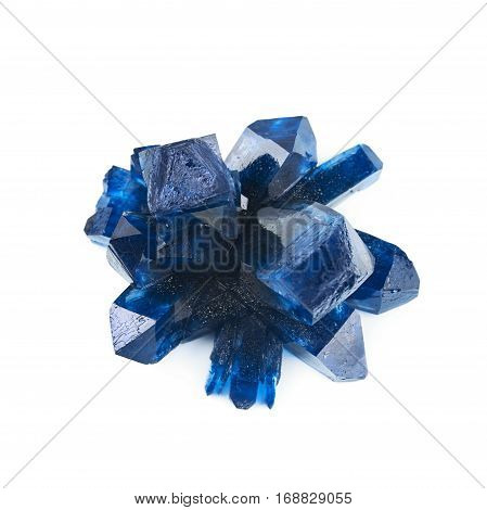 Grown crystal of blue colored salt isolated over the white background