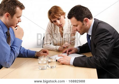 three business people talking about contract