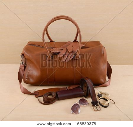 Men's casual outfits with man bag and accessories on rustic wooden background,