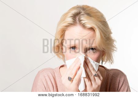 Woman Pressing Tissue On Her Nose With Copy Space