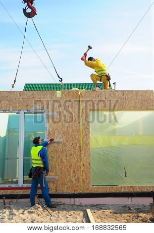 KIEV UKRAINE - January  24 2017: Builders Installing Frame House Structural Insulated Panel - SIP. Builders Building New Frame House.
