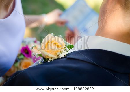 Wonderful wedding boutonniere on a costume of groom