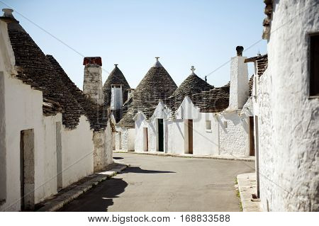 Typical trulli buildings with conical roofs in Alberobello, Apulia, Southern Italy