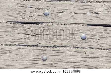 Close up of wooden planks with rivets. Background.