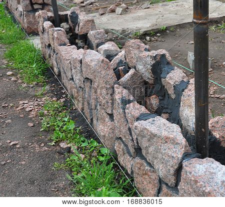 Building Granite Stone Fence. Building Granite Stone Fence with Design Decorative Cracked Stone