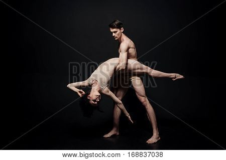 Losing my mind. Overwhelmed emotional skilled performers acting in the studio and expressing infatuation while demonstrating their abilities against black background
