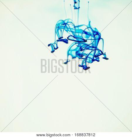Soluble in water a drop of blue dye.