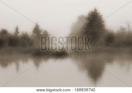 Landscape with morning fog on the river.Sepia