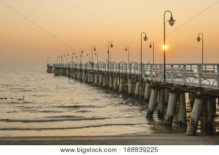 pier in gdynia orlowo in poland after sunrise in wintertime, europe