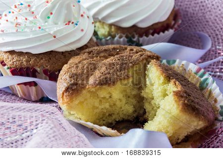 Split biscuit muffin on background of a delicious muffins with protein cream