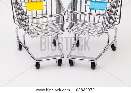 Two shopping trolley on the white background