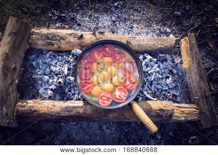 Cooking breakfast for the stake in the camping in the summer.