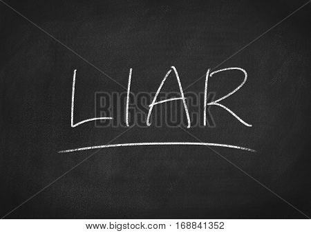 liar concept word text on blackboard background