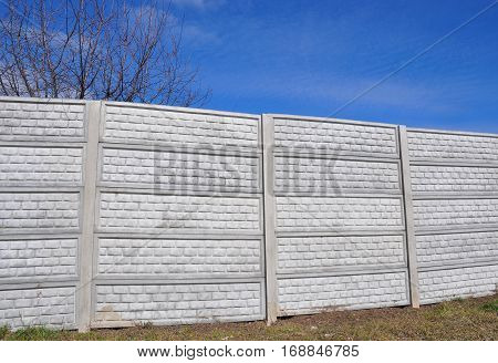 High Concrete Fence Installation. Close up on new fence