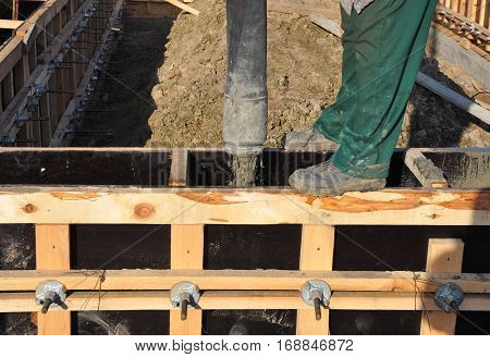 Contractor Building Foundation with Concrete.  Building Concrete foundation. Foundation Construction.
