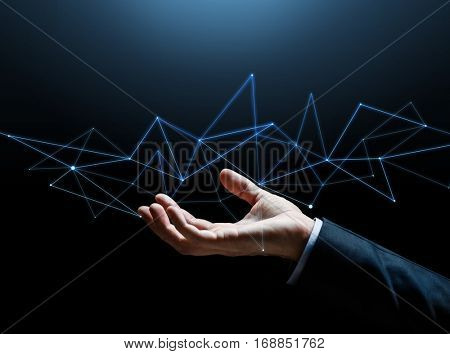 business, people, cyberspace, network and future technology concept - close up of businessman hand with hologram over black background