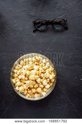 concept of watching movies with popcorn top view on dark background
