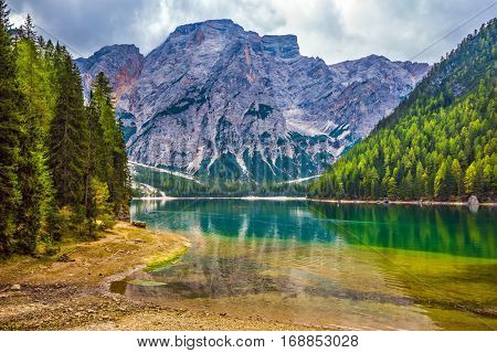 Stroll around the beautiful lake Lago di Braies. The concept of walking and eco-tourism. Travel to South Tyrol, Italy