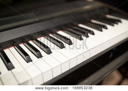 music, art, musical instruments and entertainment concept - close up of grand piano keyboard