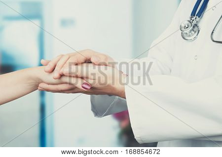 Doctor Holding Patient Hand Close Up
