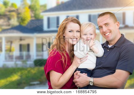Happy Young Military Family in Front of Their House.