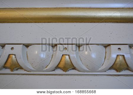 gold relief pattern on the cornice, the interior detail