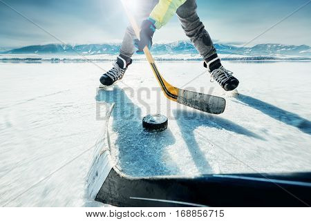 Ice hockey game on the frozen lake moment poster