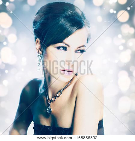 Beautiful woman with evening make-up. Jewelry and Beauty. Fashion photo. Beauty style woman with diamond accessories