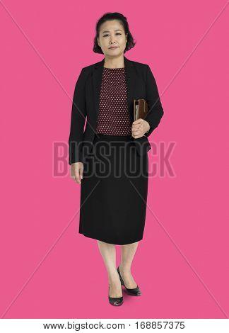 Businesswoman standing staring in formal wear