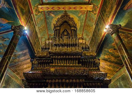 Phnom Penh, Cambodia - December 31, 2016: View of Wat Phnom temple interior. Wat Phnom is a Buddhist temple built in 1372, and is the tallest religious structure in Phonm Penh, the cambodian capital