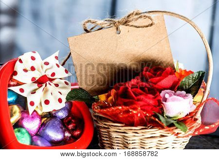 Valentine's day love and sweetest concept, rose and chocolate.  Holiday background with copy space.