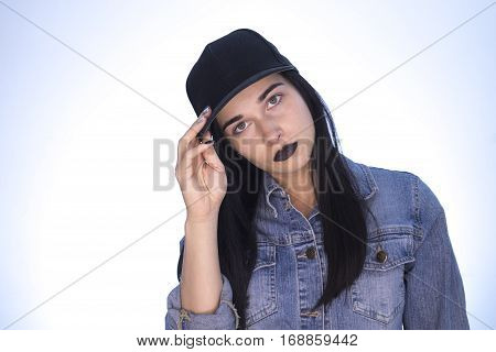 Beautiful Girl. The Girl In Glasses On A Light Blue Background