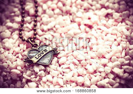 Valentine's day and sweetest concept, love idea with heart pendant. Holiday background with copy space.