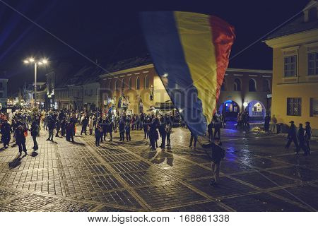 Protester Waving Romanian Flag