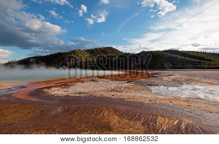 Grand Prismatic Hot Spring under western cloudscape in the Midway Geyser Basin in Yellowstone National Park in Wyoming