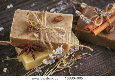 Natural handmade soaps with salt coffee beans cinnamon anise star and dried lavender flowers