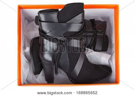 Black ankle boots in a box isolated on white
