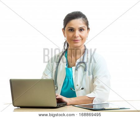 Medical doctor woman working with computer isolated over white background.
