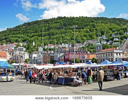 Bergen, Norway - June 5, 2009: People shop at the market in Bergen (Norway). At many of the market stalls fresh fish and seafood are offered. But there are also sold fruits, vegetables, handicrafts and souvenirs.