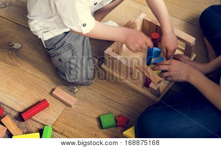 Little Children Playing Toy Blocks