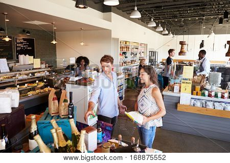 Interior Of Busy Delicatessen With Customers