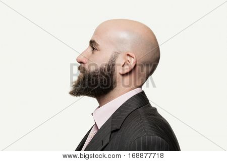 Young bald man with a beard wearing a stylish jacket