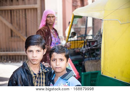 Jodhpur India - 2015 January 4 : Two young Indian kids posing outside for the camera with a selfconfident look in Jodhpur
