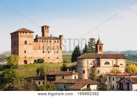 Grinzane Cavour Italy - 2016 September 27 : The village of Grinzane Cavour in the Piemonte region of Italy with its castle in the background