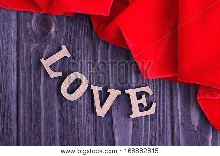 Valentine's Day Elegant Still Life With Love Lettering And Red Fabric On Wooden Background