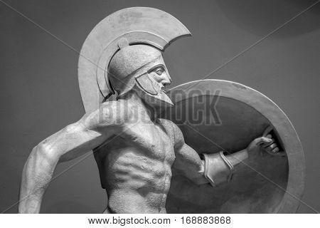Head in helmet Greek ancient sculpture of warrior.